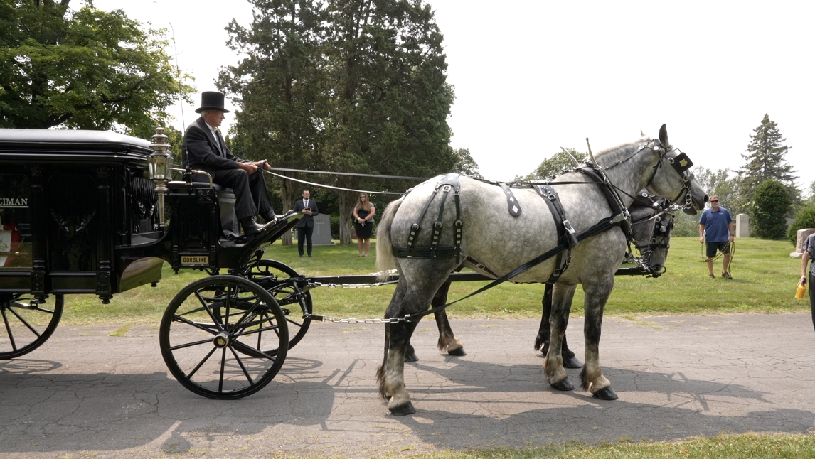 Horse and carriage arrived to the burial site with Lt. Parker's remains