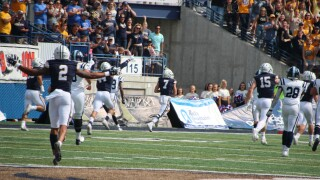 DB Ty Okada takes the ball into the end zone on his pick-six