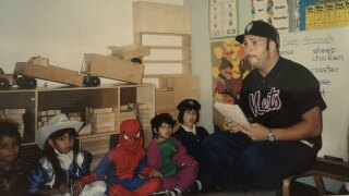 Enrique Vela teaches kindergarten children in Queens, New York
