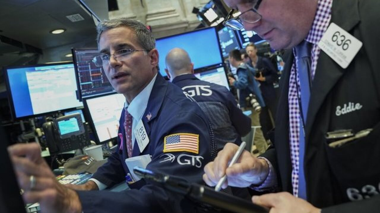 Dow soars 287 points but still suffers worst week since March