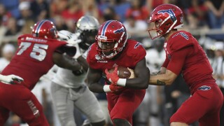 FAU football running back Malcolm Davidson, QB Chris Robison, September 2019
