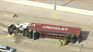 An overturned tractor-trailer on Interstate 95 near Okeechobee Boulevard in West Palm Beach.jpg