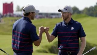 Brooks Koepka and Daniel Berger fist bump at Ryder Cup, Sept. 24, 2021