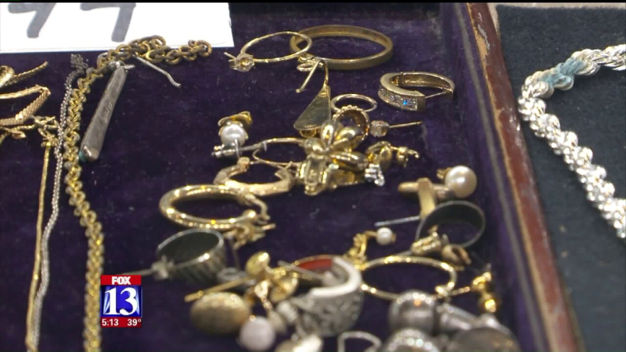 Hidden stash of coins, jewelry to be auctioned to repay victims in $25 million fraud case