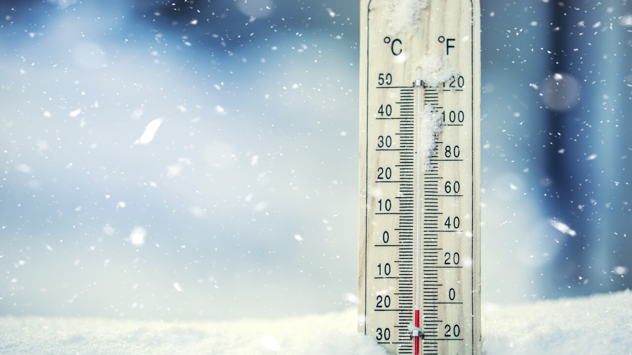Thermometer,On,Snow,Shows,Low,Temperatures,In,Celsius,Or,Farenheit.