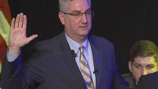 Holcomb looks back in first speech as governor