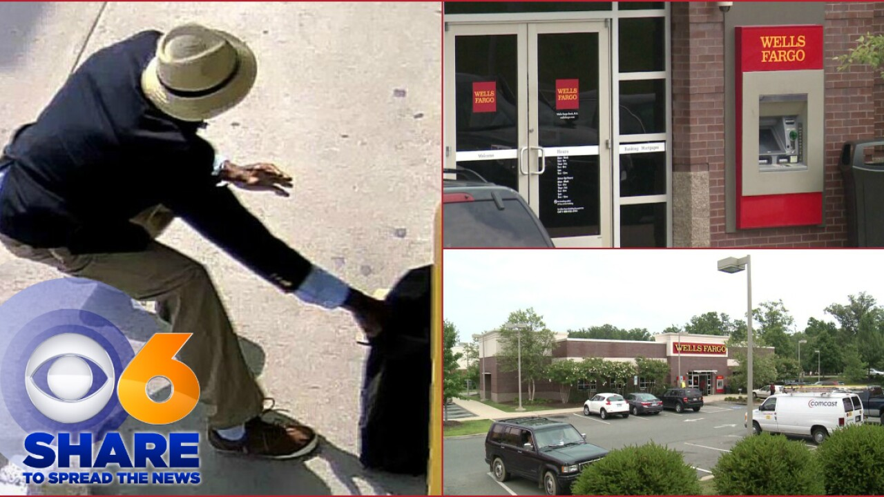 SHARE! Photo shows suspect robbing armored truck driver filling Wells FargoATM