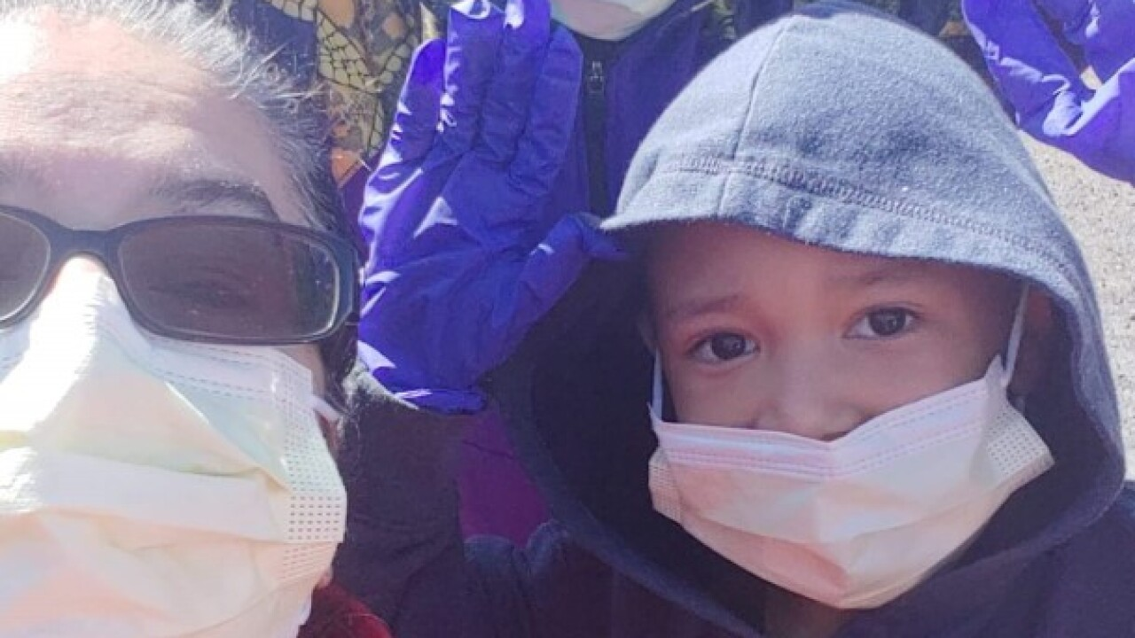 Yvonne Perez and her two foster children wear face masks to protect against COVID-19.
