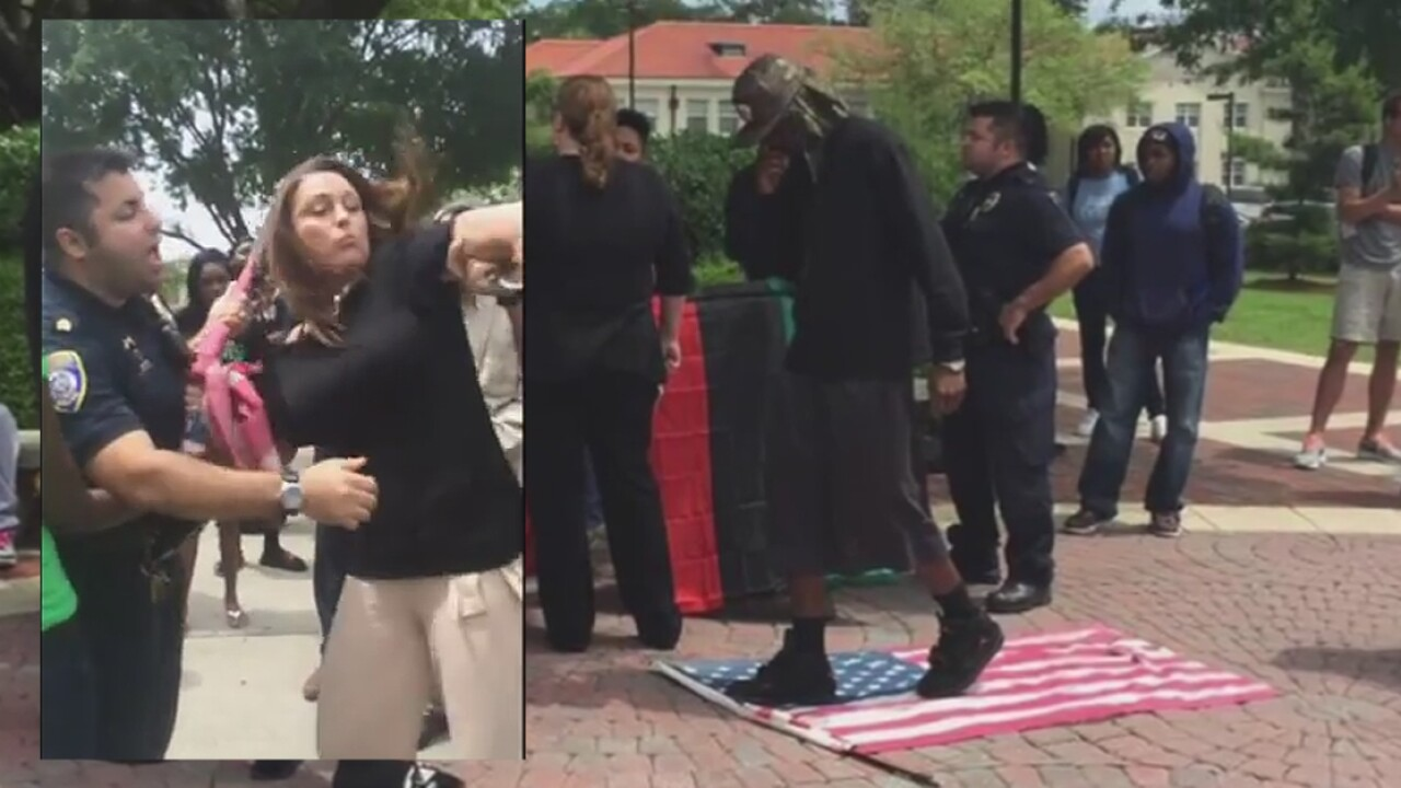 University bans Air Force veteran Michelle Manhart after she attempted to save American flag during campus protest