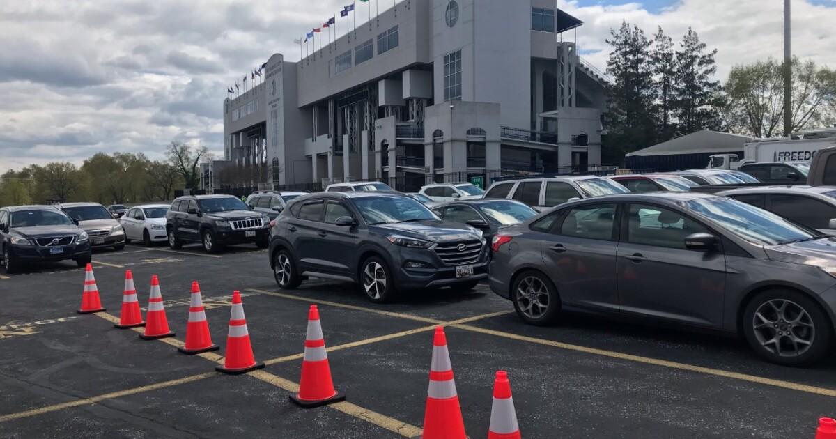 Maryland governor tours mass vax site at Navy Stadium