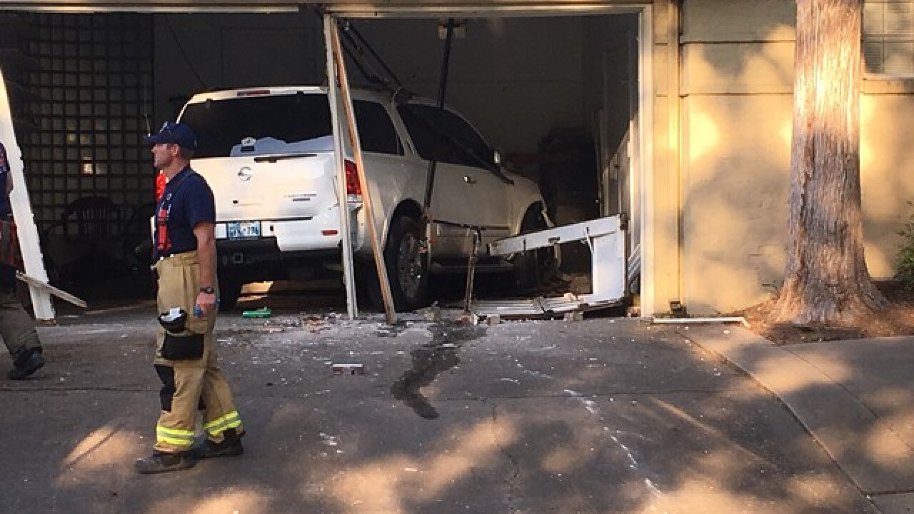 Car runs into midtown Tulsa home