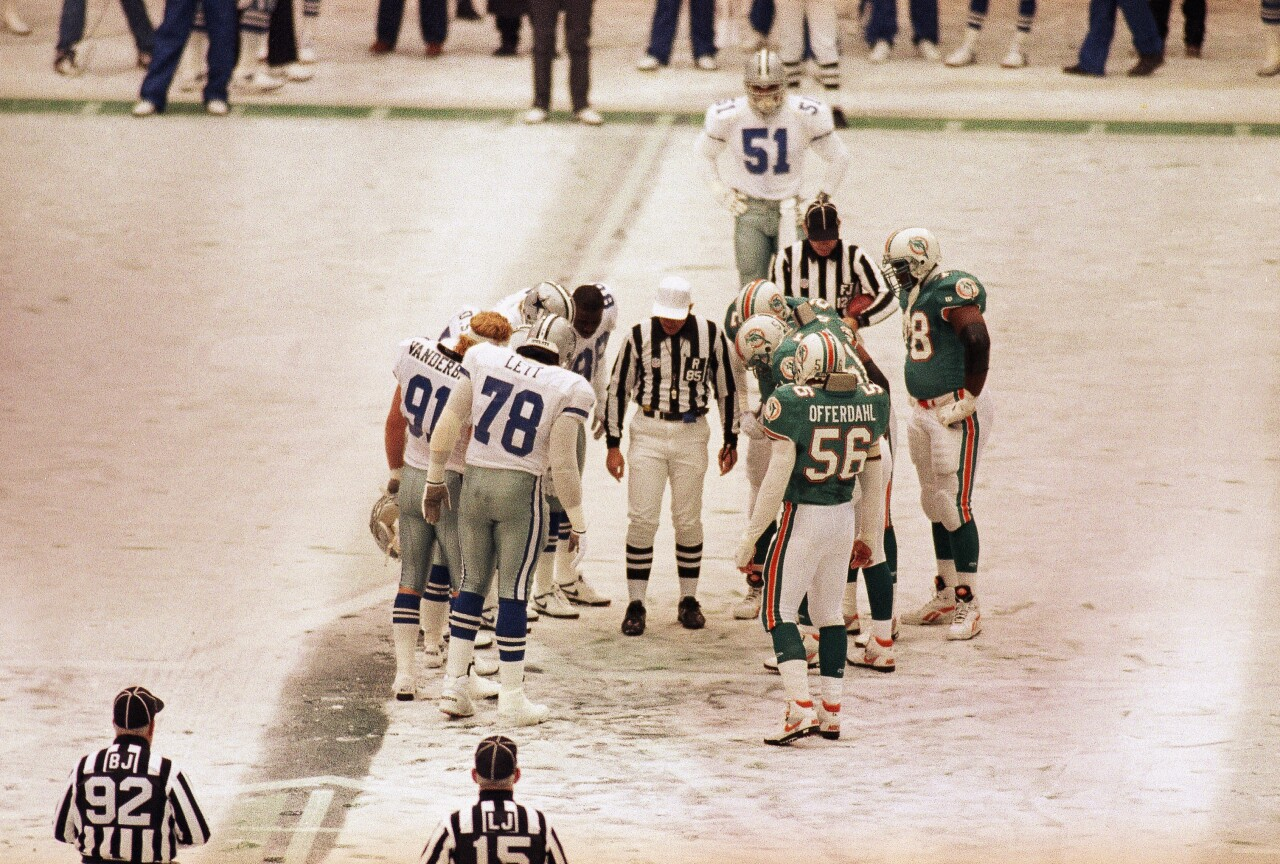 Miami Dolphins and Dallas Cowboys meet on snow-covered field at Texas Stadium on Thanksgiving in 1993