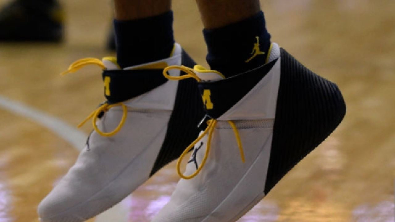 Michigan wants to know if athletes sold team-issued shoes