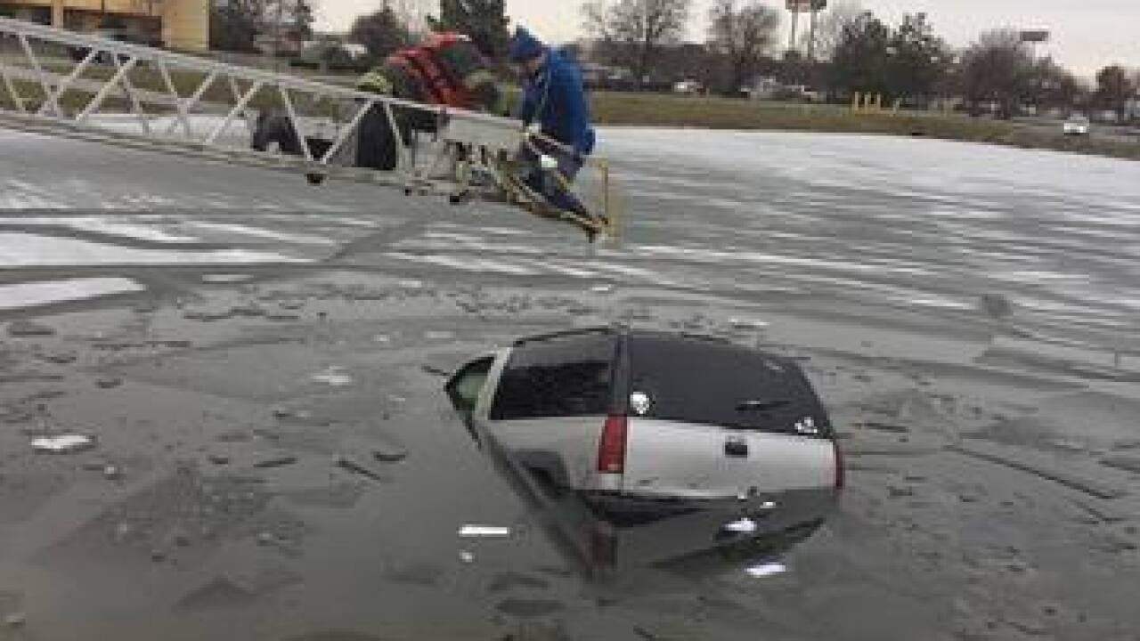 PHOTOS: SUV pulled out retention pond on NE side