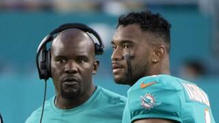 Miami Dolphins head coach Brian Flores and QB Tua Tagovailoa look to field during 2021 preseason game against Atlanta Falcons