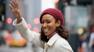Woman Hailing a rideshare