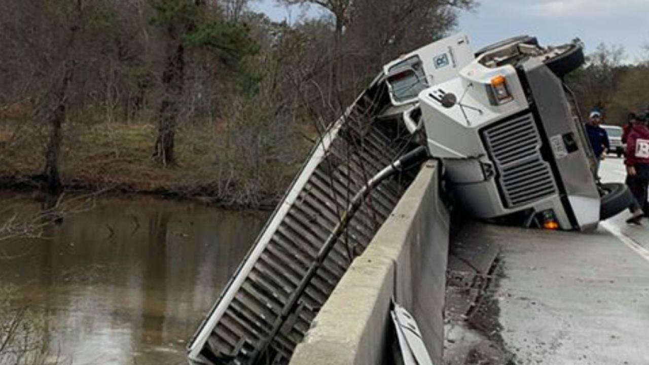 Crash leaves dump truck dangling over New Kentbridge