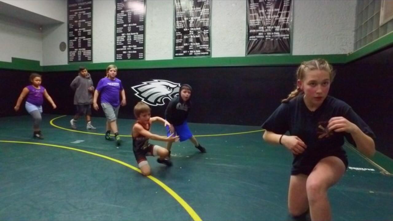 Girl wrestler takes down barriers & boys