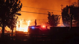 Death toll jumps sharply as wildfires continue to rage uncontrolled in western states