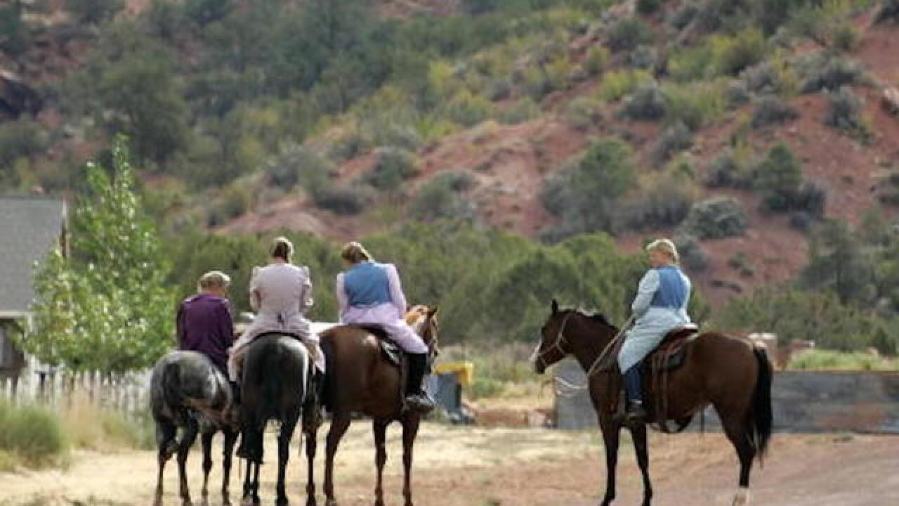 Leaders of polygamous sect arrested for fraud
