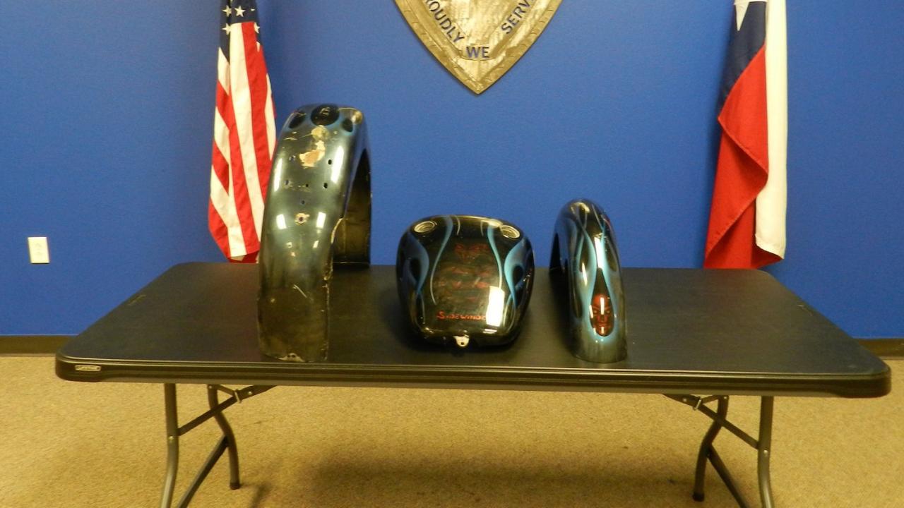 Custom-painted motorcycle fenders, gas tank returned 7 years