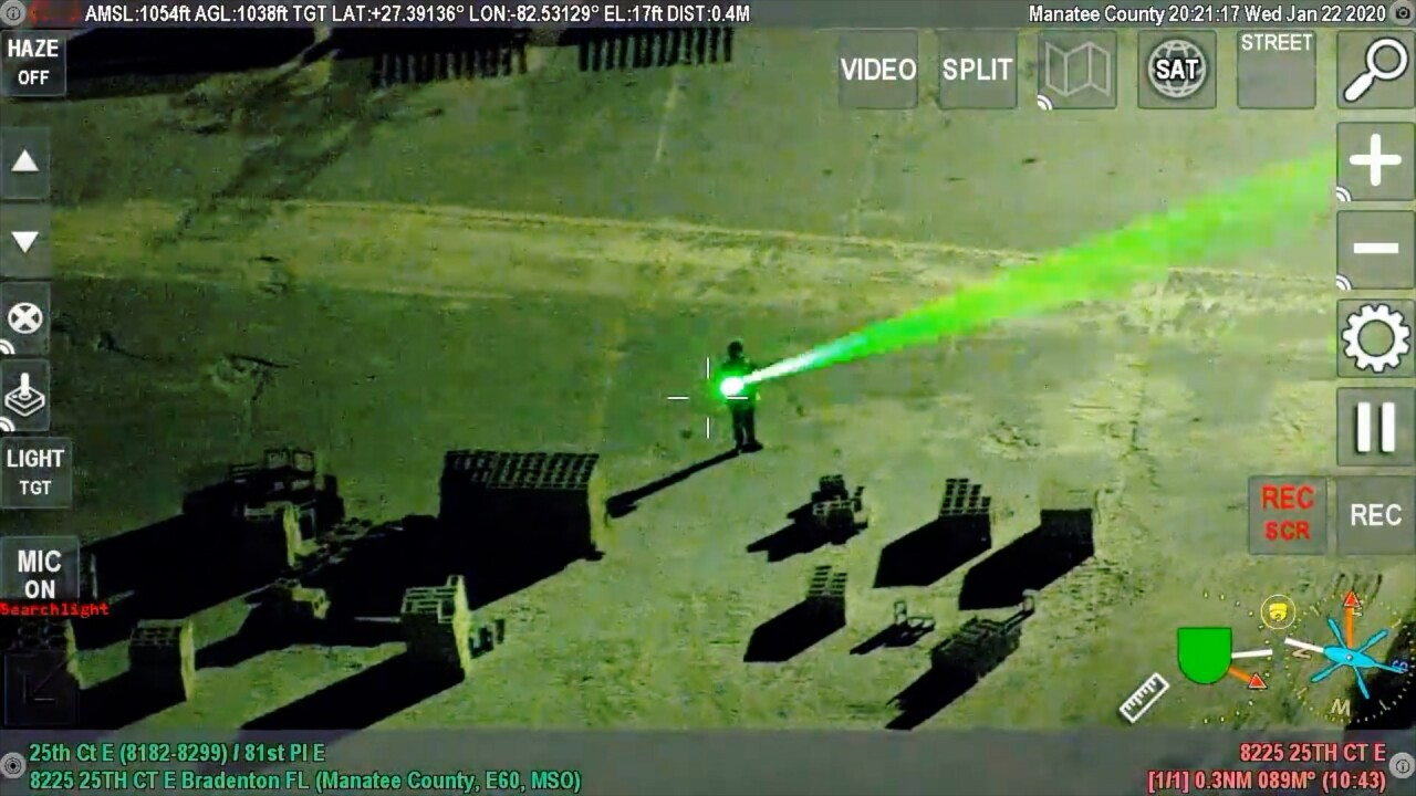 A still from a video provided by the Manatee County Sheriff's Office of a suspect targetting an aircraft approaching Sarasota Bradenton Airport with a laser pointer on January 2020.