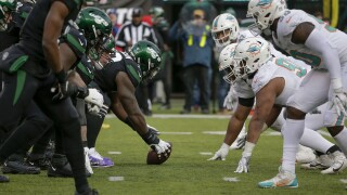 Dolphins game at Denver postponed; Miami to host Jets next weekend