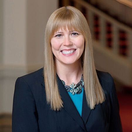 Meghan Cummings is the executive director of the Women's Fund of the Greater Cincinnati Foundation. She has long, strawberry blonde hair and is wearing a turquoise blouse and dark jacket in this portrait.
