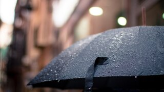 WCPO rainy raining umbrella weather.jpg