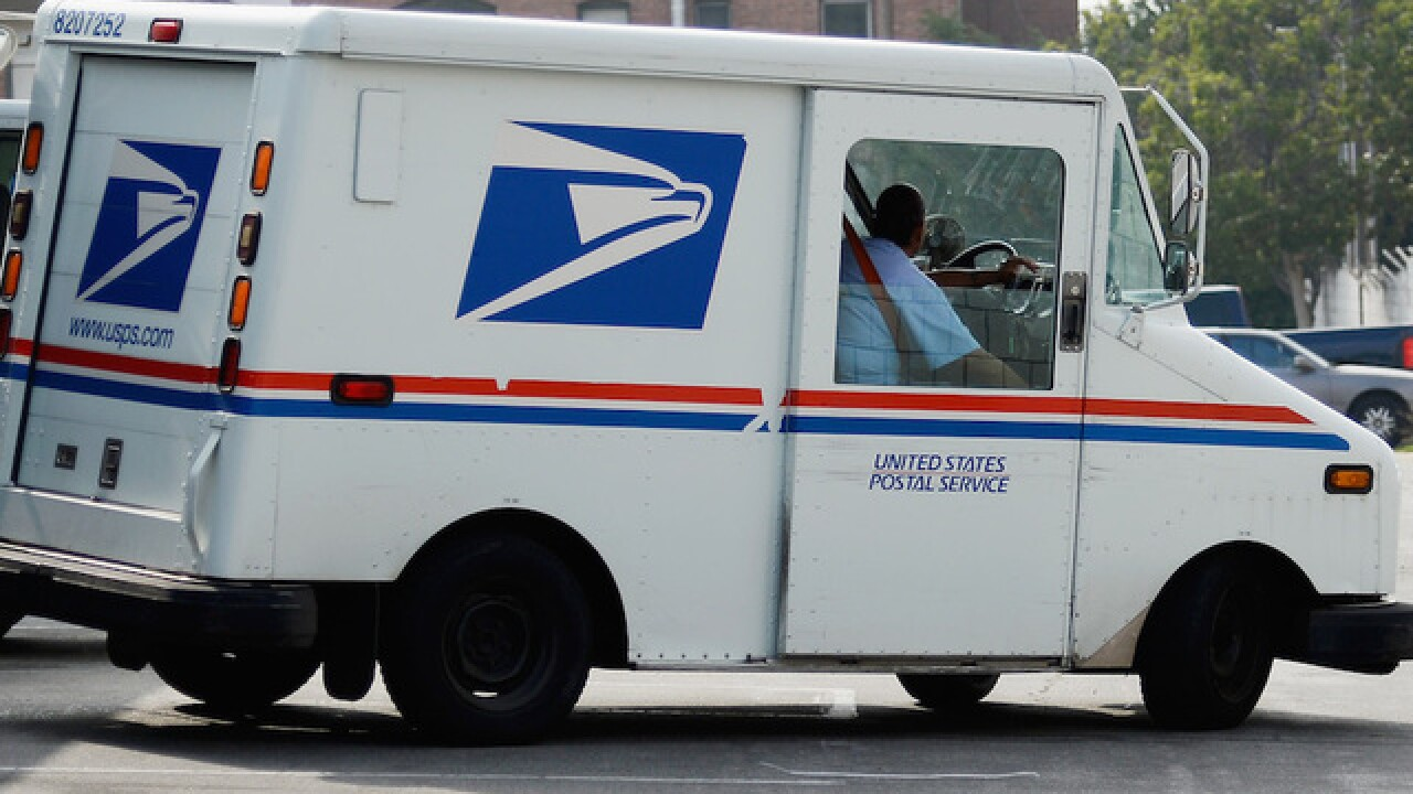Suspect accused of killing two Ohio postal workers charged