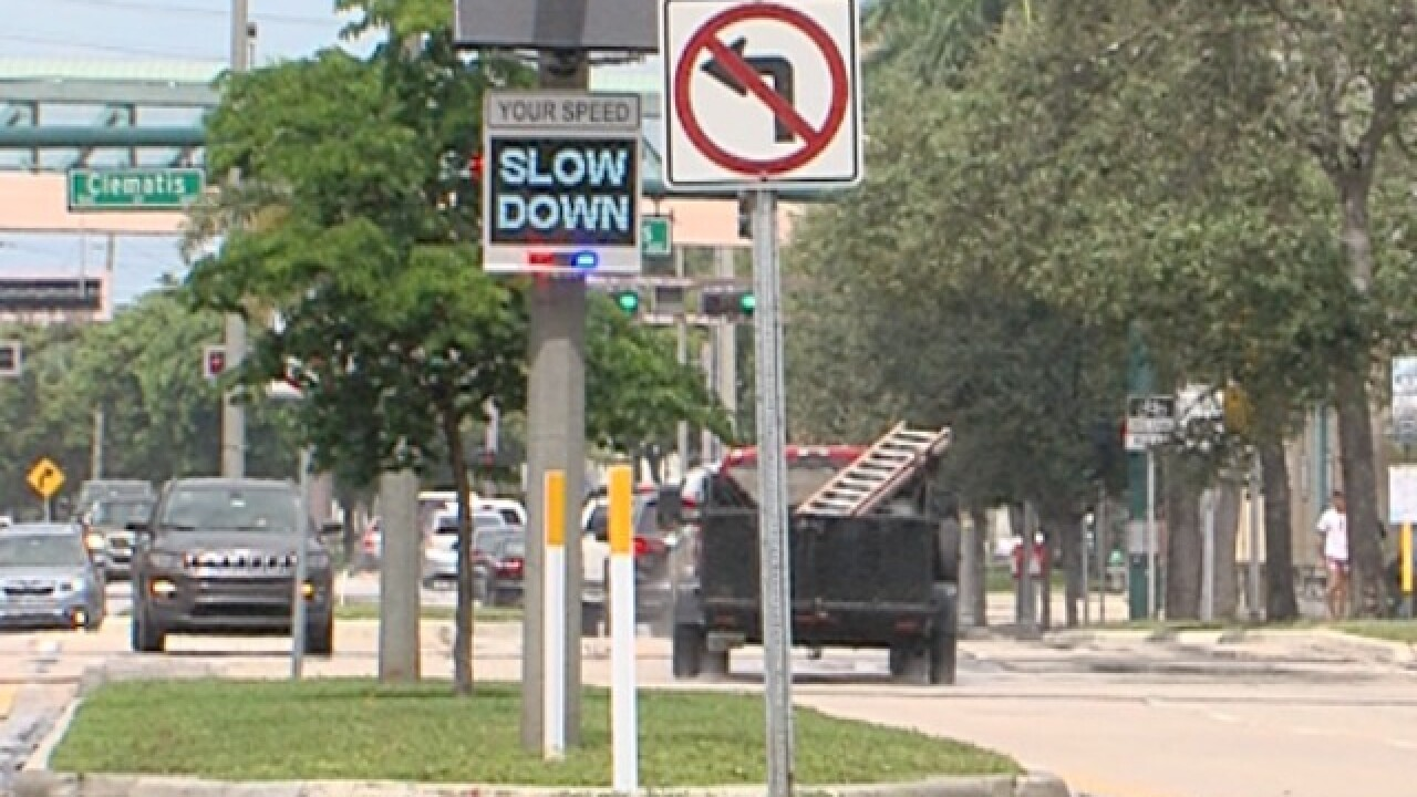 Signs encourage drivers to slow down in West Palm Beach