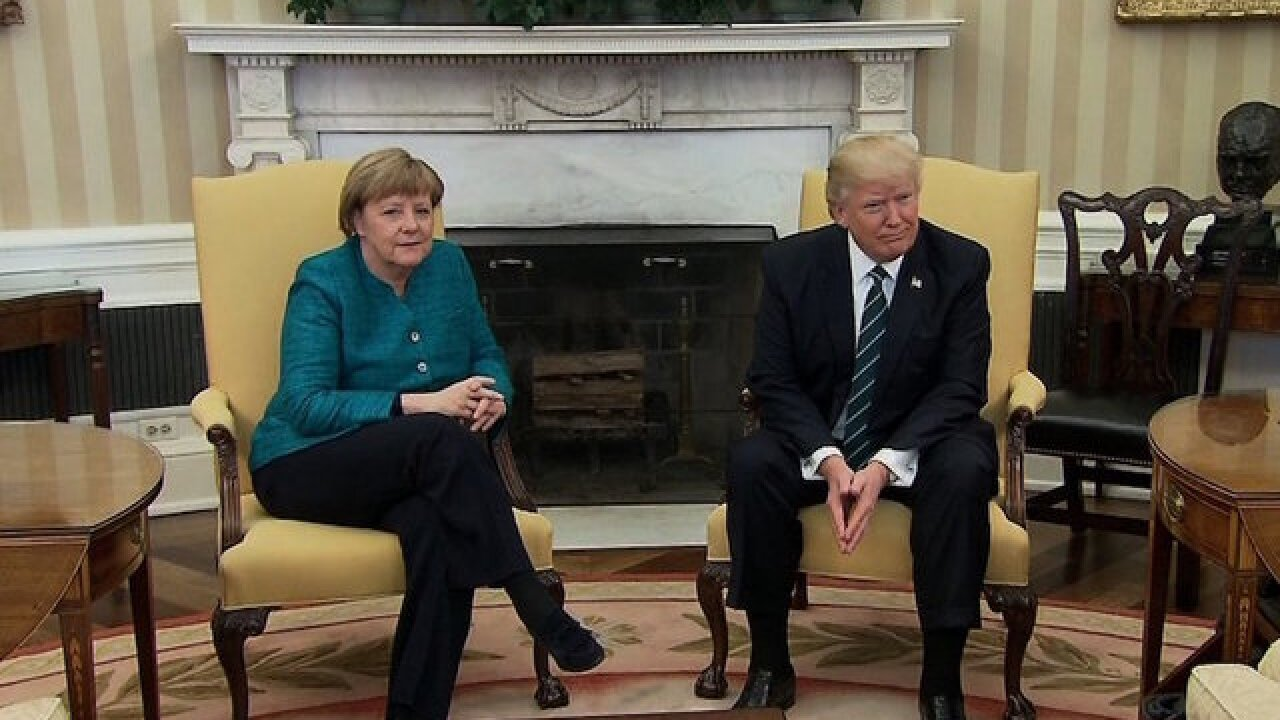 Trump says he has something in common with Merkel, insinuates wire tapping claim