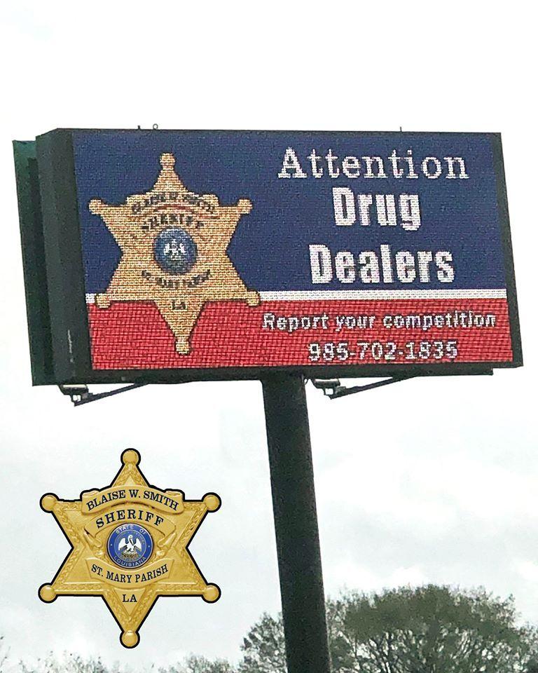 Drug dealers report competition (billboard).jpg