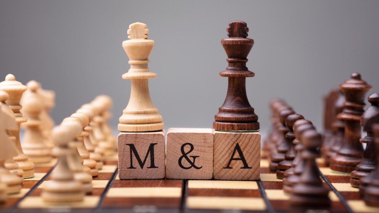 King Chess Pieces With Mergers And Acquisitions Text