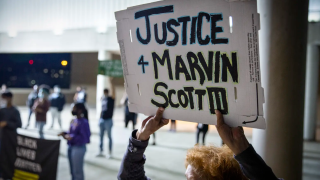 Shannon Borders held up a sign at a March demonstration outside of the Collin County Jail to demand justice for Marvin Scott III, who died while in custody at the jail..PNG