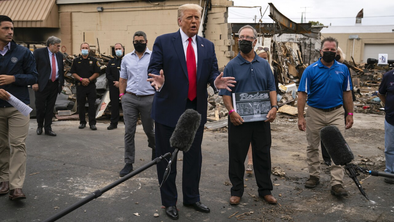Kenosha business owner declined photo-op with President Donald Trump, former owner replaced him