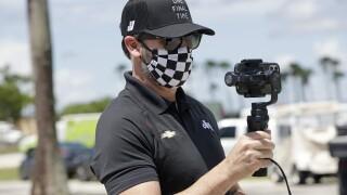Jimmie Johnson 1st NASCAR driver to test positive for virus
