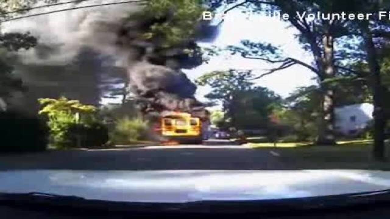 Bus driver pulls 20 kids from burning bus