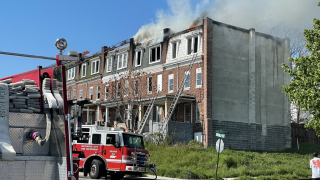 Two-alarm fire breaks out at Baltimore rowhomes, no injuries reported.png