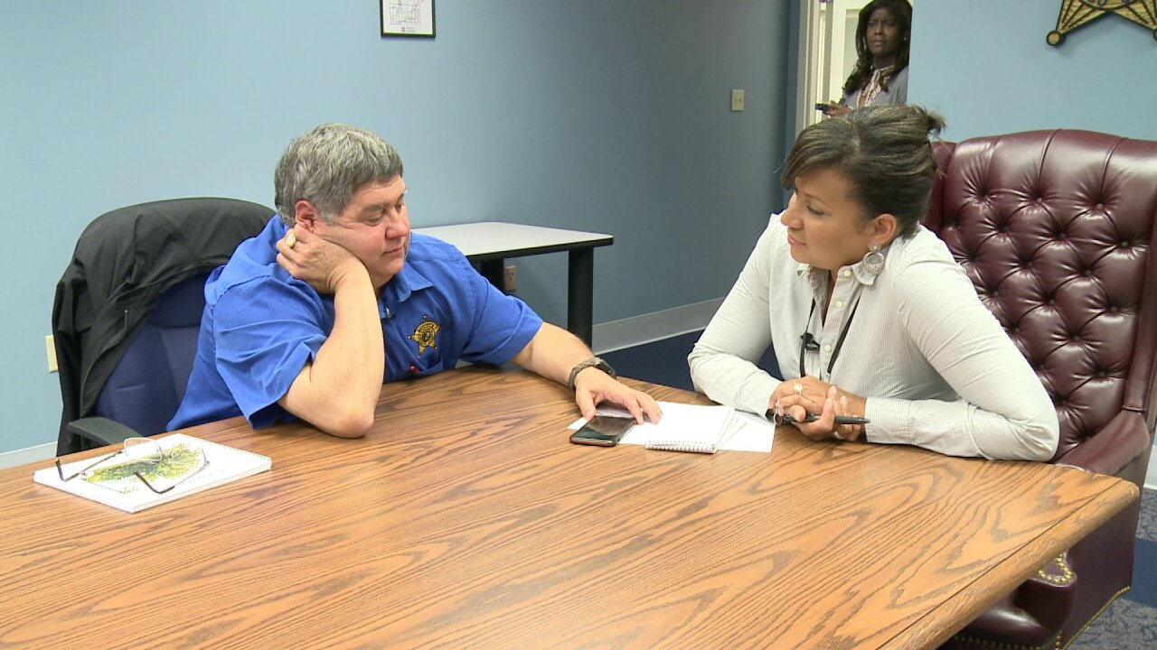 Alleged scammer tells reporter he's making thousands a day in front of Henrico sheriff