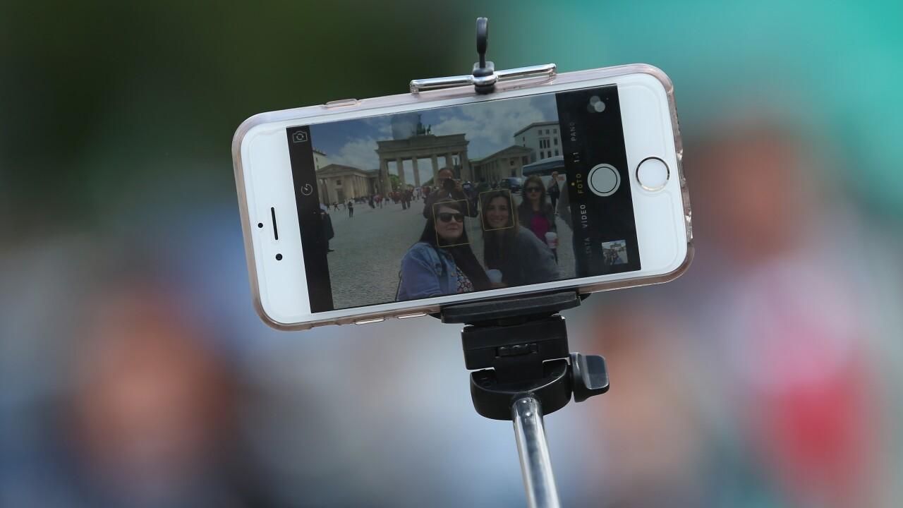 Tourists With Selfie Stick