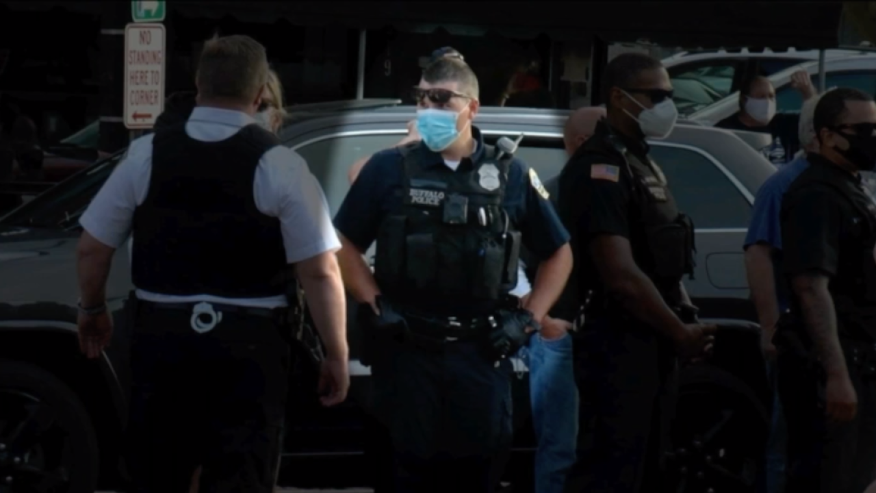 Buffalo police officers covered name tags with tape while patrolling Tuesday protest