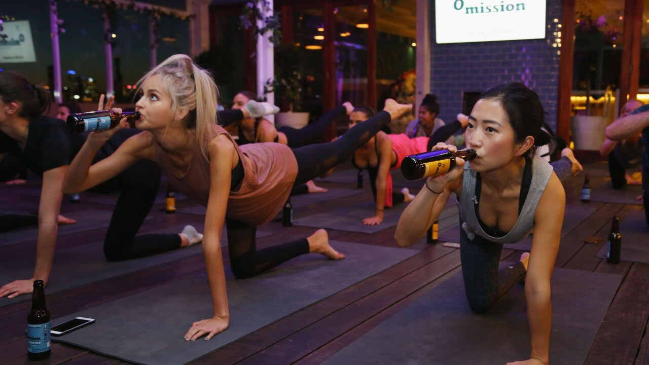 Melburnians Take Part In Beer Yoga Class