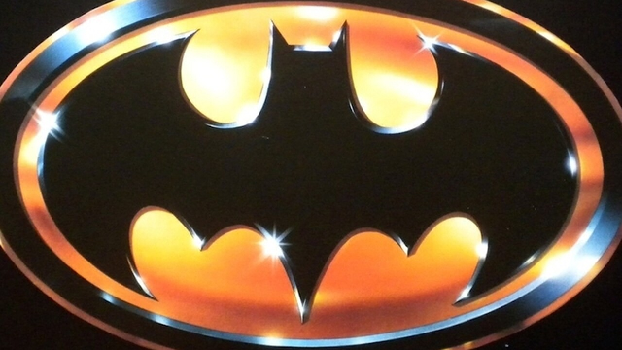 Cops: Seattle man arrested after throwing 'Batarang' at police car