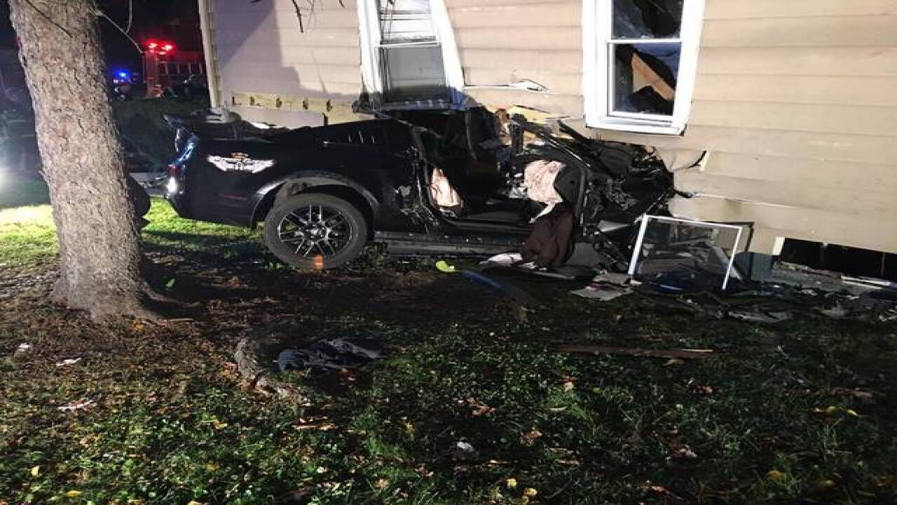 Car barrels into Maple Heights home