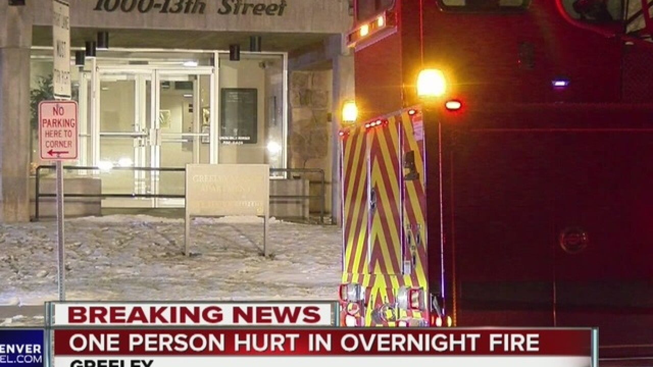 Firefighters pull man out of apartment fire
