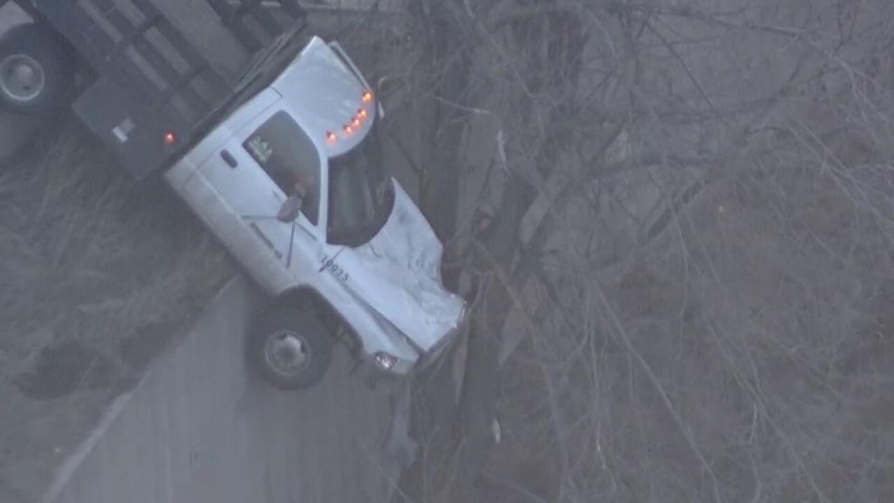 Truck hangs over edge of I-25 above Platte River
