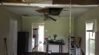 Family finds themselves in unlivable conditions after rental home roof caves in