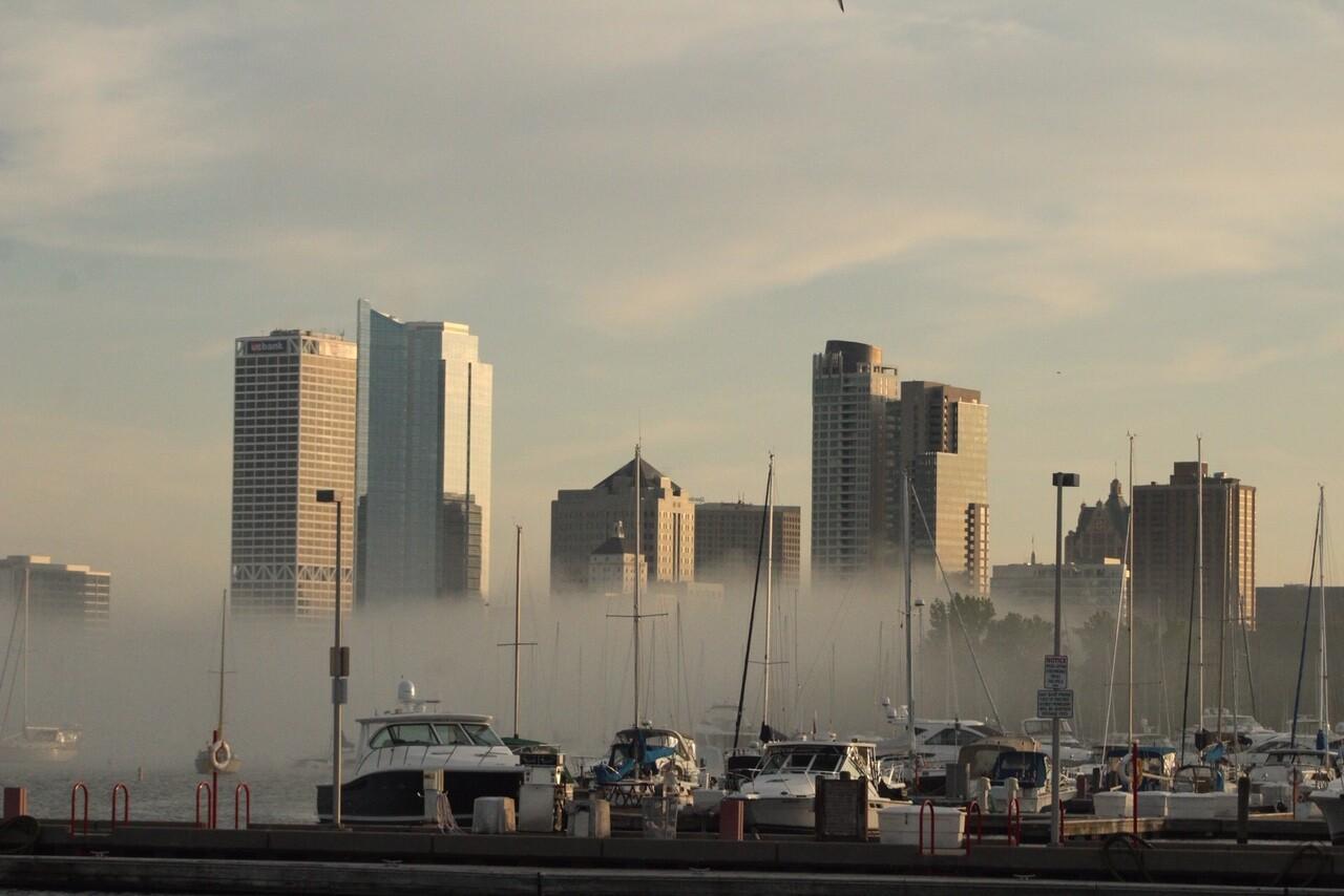Dense fog floods downtown Milwaukee on Thursday evening.
