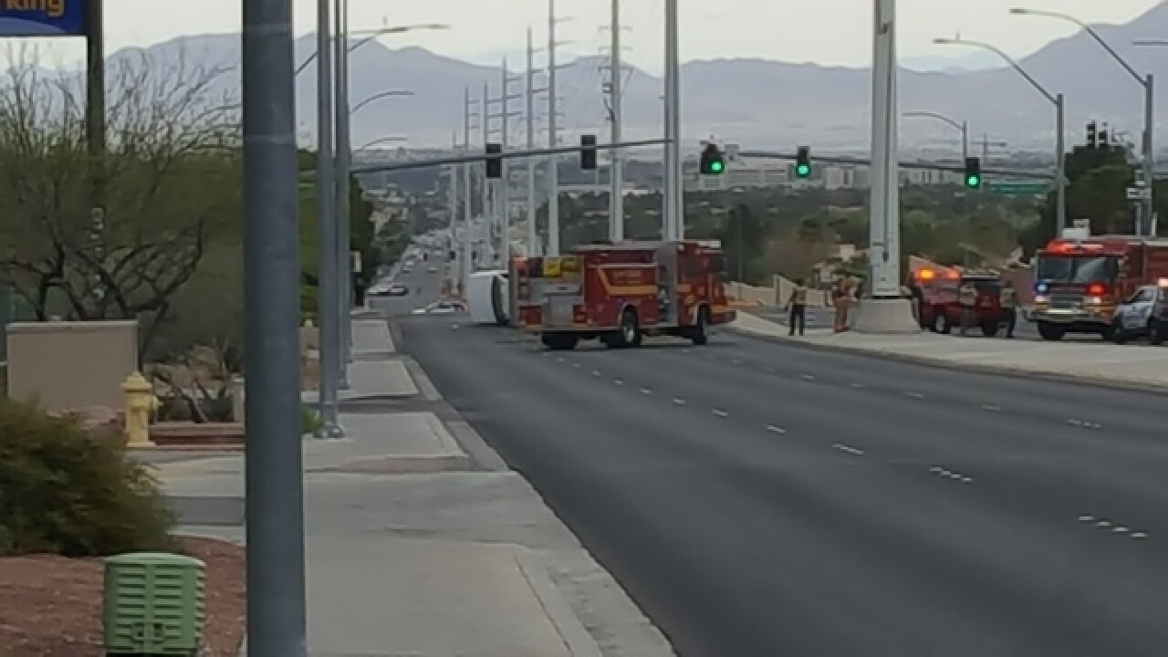 Truck possibly carrying chemicals rolls over